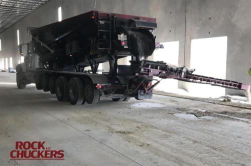 Slinging gravel on a commercial job site.
