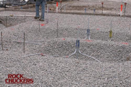 Slinging gravel at Meadowview School.