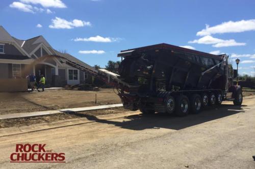 Slinging topsoil at a new home site near Mason, Ohio.