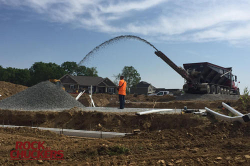 Placing gravel in the walkout basement area at a new home in Troy, Ohio.