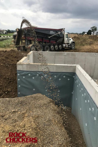 Easy way to backfill a foundation wall.